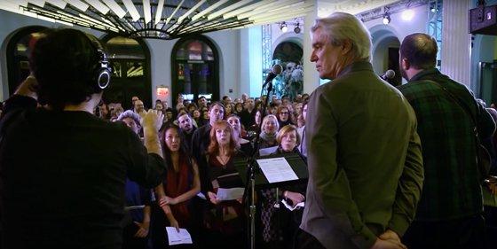"Watch David Byrne and Choir! Choir! Choir! Team Up to Cover David Bowie's ""Heroes"""