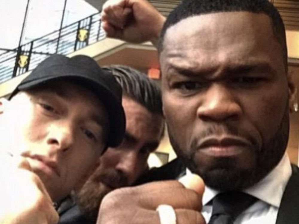 "50 Cent Salutes Eminem & Flames Floyd Mayweather In Nike-Inspired Fake Ads: ""Champ Must Have Done This One Himself"" –"