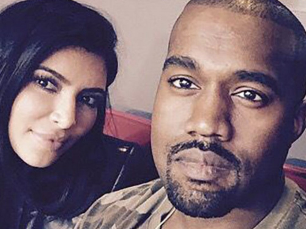 "Kanye West Flexes Muscles Carrying Kim Kardashian: ""Still Sweeps Me Off My Feet"" –"