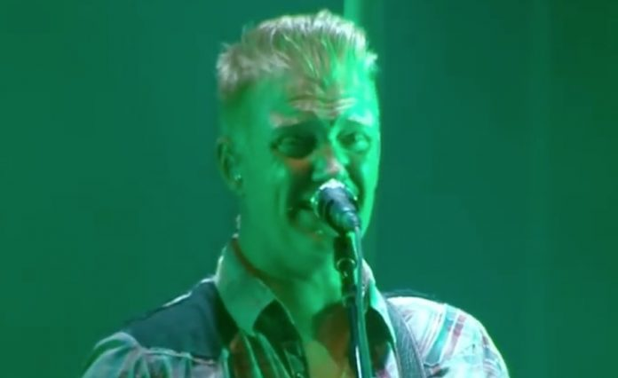 Watch Queens of the Stone Age's Josh Homme Jump Into Pit At Show