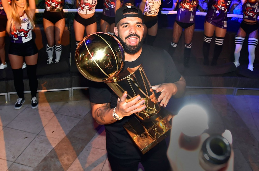 Drake Rides With Toronto Raptors for Championship Parade, Chugs Beer Tossed by Fan: Watch