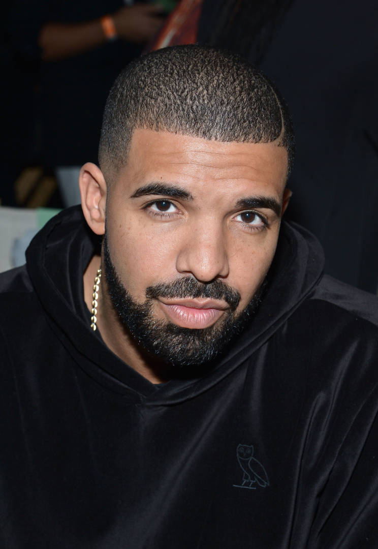 Why Does Drake Look Like A Grandpa In This Picture?