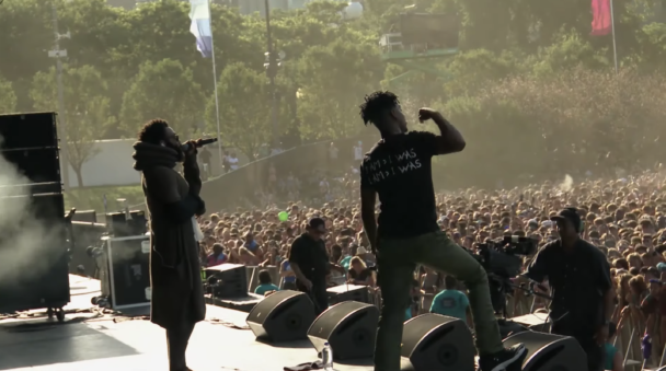 """Watch Childish Gambino Join 21 Savage For """"Monster"""" At Lollapalooza"""