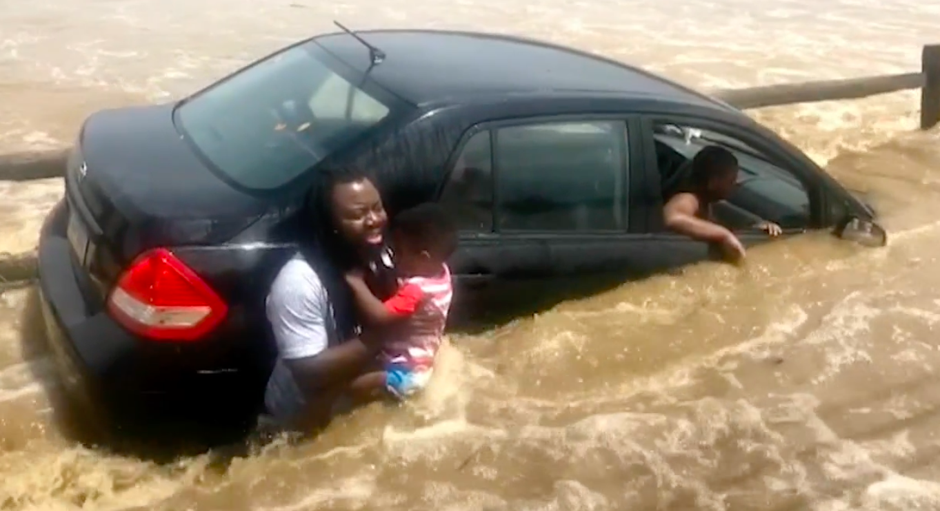 [WATCH] Group Of Strangers Suddenly Appear And Rescue Family From Floodwaters