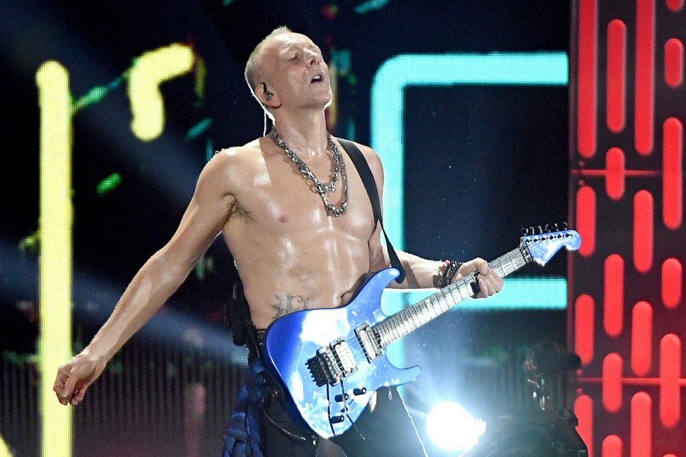 Why Def Leppard's Phil Collen Still Plays With His Shirt Off in His 60s