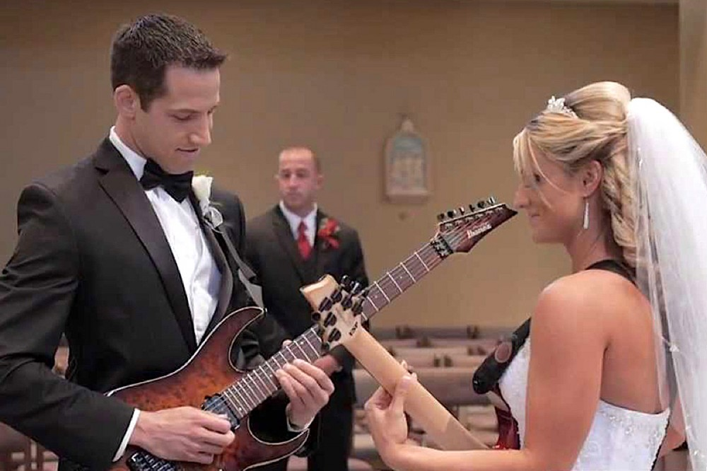 Watch This Shred-Tastic Wedding Entrance With Bride + Groom Guitarists